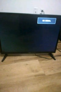 black flat screen TV with remote San Francisco, 94103