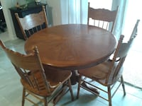 Round Brown Oak pedestal table with four chairs dining set NIAGARAFALLS
