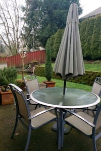 Table, chairs and umbrella