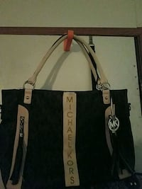 black and brown Michael Kors leather tote bag Round Rock, 78681