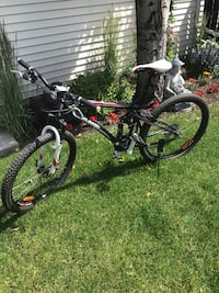 24 Speed Cranked Bike mid shock & front excellent condition helmet lock water bottle padded gloves