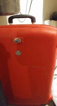 Red suitcase 3484 km