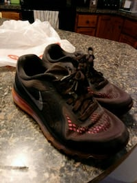 pair of black-and-red Nike running shoes