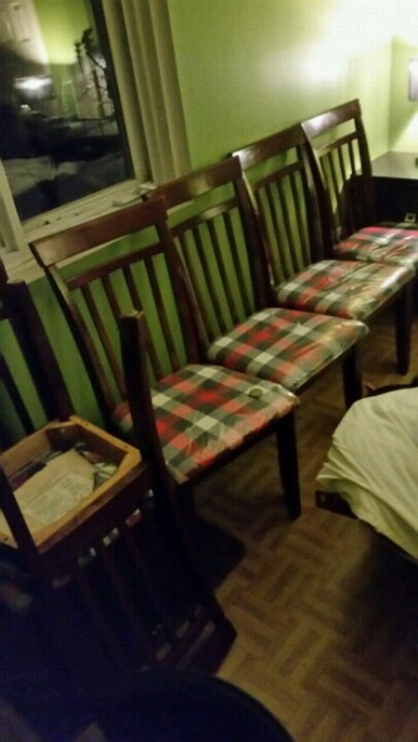 brown wooden framed green and pink padded chair