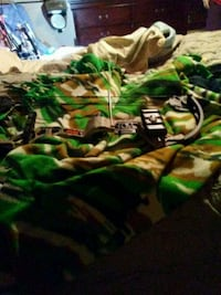 green and black camouflage textile Gray, 31032