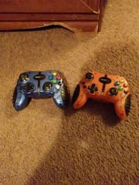 two black and red Xbox 360 controllers Stafford, 22554