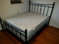 Queen size bed with bed frame  1482 mi