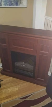 Brown faux fire place with working flames and heat Toronto, M6N 2E8