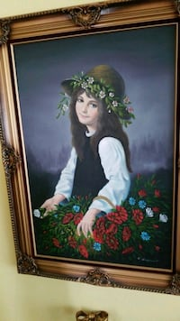 framed painting of woman wearing white and black long-sleeved top Montreal, H3R 3L4