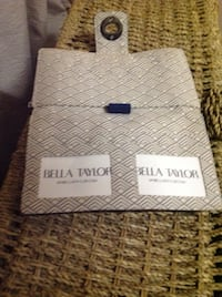 Blue Bella Taylor wallet equipped for cash and credit cards; side zip included. SF, 94123