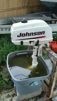 white and black Johnson outboard motor Westhampton Beach, 11978