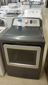 white and gray front-load clothes dryer