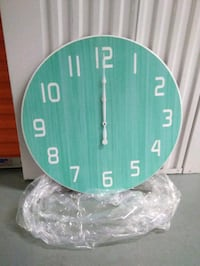 round teal and white analog wall clock 29 km