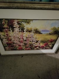 pink and red petaled flowers painting with brown frame