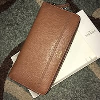 brown leather Fossil wristlet with box