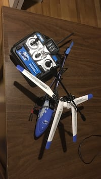 blue and gray R/C helicopter with remote control Halifax, B4C 4A2
