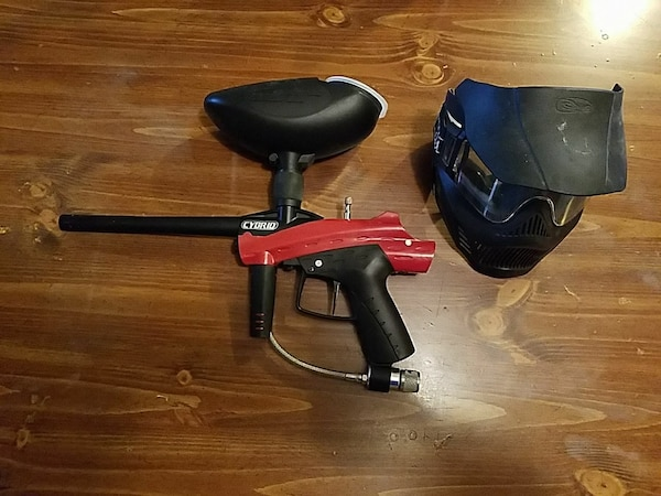 black and red paintball gun and paintball mask