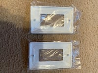 Two brand new white light switch covers
