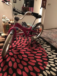 Red and black bicycle with training wheels Montgomery Village, 20886