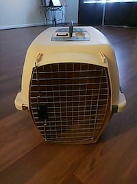 white and brown pet carrier Cary