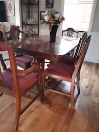 Rectangular brown wooden table with six chairs dining set