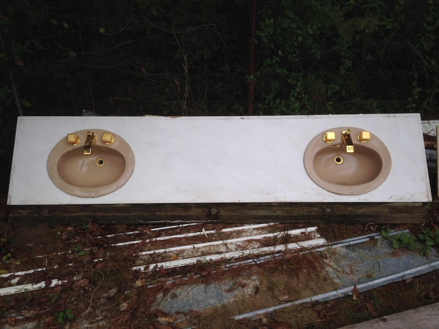 Photo Double vanity top with cast iron sinks with yellow brass fixtures