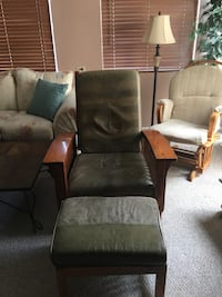 brown and green armchair with ottoman