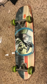 gray, black, and beige Shrek and Donkey print skateboard