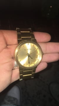 round gold-colored analog watch with link bracelet 1616 mi