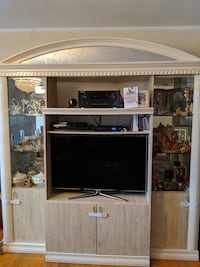 brown wooden TV hutch with flat screen television New York, 11374