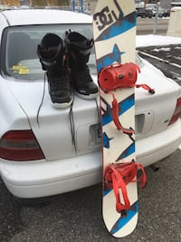 white, teal and red Dyrdek snowboard with snow boots