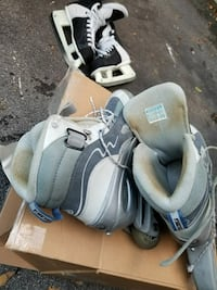 gray-and-white inline skates with box