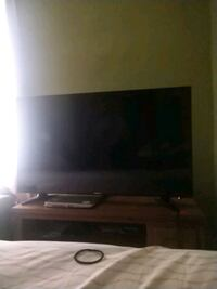 black flat screen TV with remote Creston, 50801