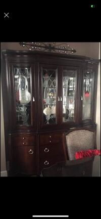 "China  cabinet/ hutch. Dark brown, solid wood. 54"" wide x 81"" tall x 15"" deep GUC (2 pieces). Scroll more pictures and see details Port Moody, V3H 4C6"
