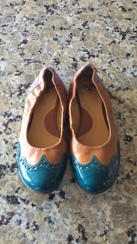 Pair of blue-and-brown leather flats. Size 8 small  Calgary, T3M 0N1