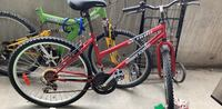 red and black hard tail mountain bike Toronto, M4C 5L7