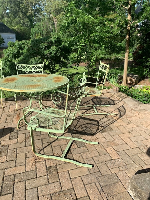 Vintage wrought iron patio outdoor table n 4 chairs 50+ yrs old. 5b7c78cf-fe48-407b-8835-564bc507b6a4