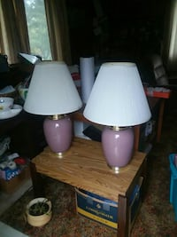 two purple table lamps with white lampshades