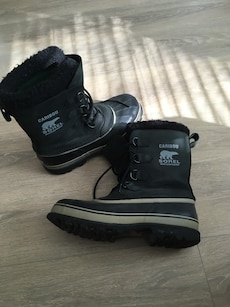 pair of black-and-white high boots
