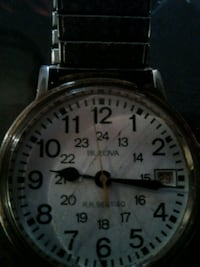 round silver-colored chronograph watch with link bracelet Edmonton