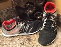 New Balance black, red, and white running shoes