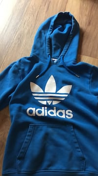 blue and white Adidas pullover hoodie