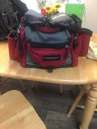 black, gray and red Revolution duffel bag