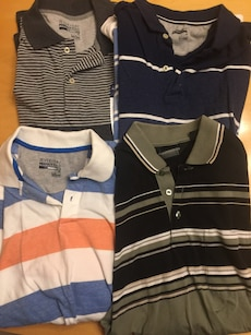 Four brand new medium polo shirts