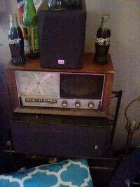 brown wooden TV hutch with black CRT TV 374 mi