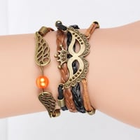 New Crown Mask Wing Leather Woven Charm Bracelet. Calgary