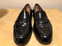 pair of black leather dress shoes 65 km