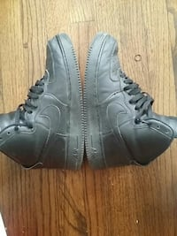 pair of black Nike Air Force 1 shoes