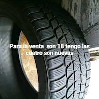 black Michelin vehicle tire with text overlay Norwich, 06360