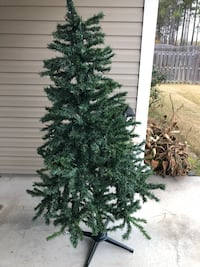 6 ft Christmas tree with multicolored lights. Will trade for a tree with clear lights or just sell